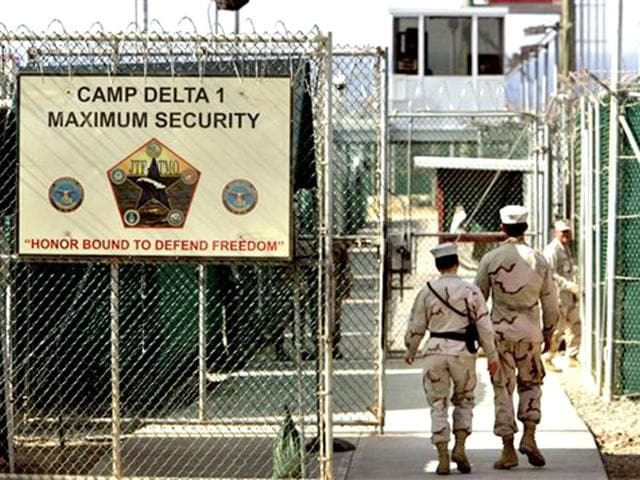 US guards walk within the Camp Delta military-run prison at the Guantanamo Bay US Naval Base in Cuba.