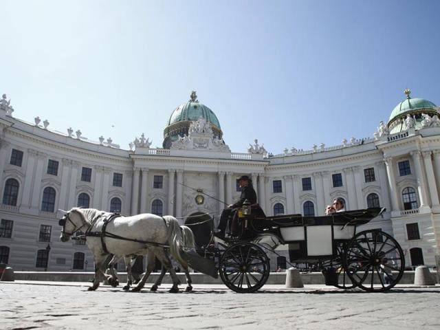A Fiaker horse carriage in front of the Hofburg Palace in Vienna.