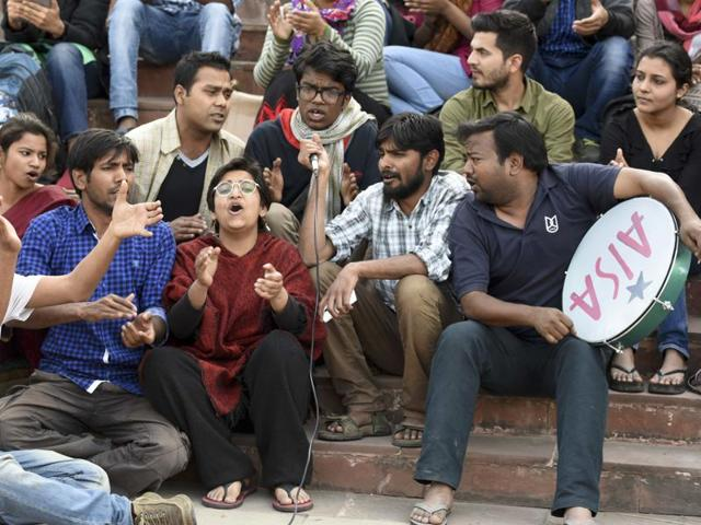JNUSU supporters protest in front of a gathering in front of Admin Building in New Delhi .