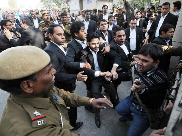 Lawyers assault a journalist outside Patiala House Court in New Delhi.