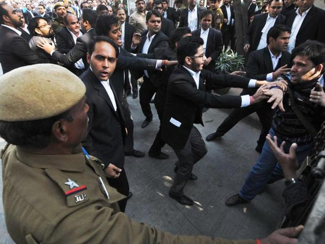 Lawyers raise the Indian flag and shout slogans at Patiala House Court, in New Delhi.