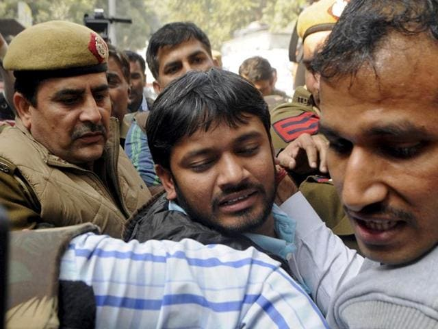 Kanhaiya Kumar (centre), head of the student union at Jawaharlal Nehru University (JNU), is escorted by police outside the Patiala House court in New Delhi.
