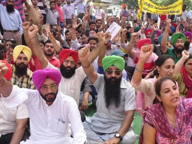 Teachers staging a protests against the Punjab government on Monday.