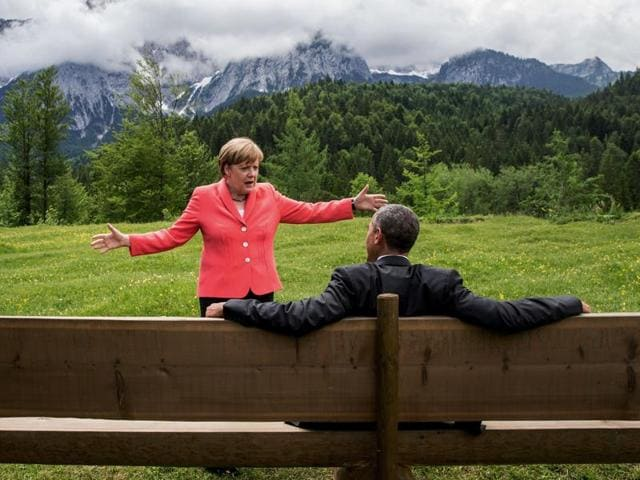 German chancellor Angela Merkel speaks with US President Barack Obama at Schloss Elmau hotel near Garmisch-Partenkirchen, southern Germany