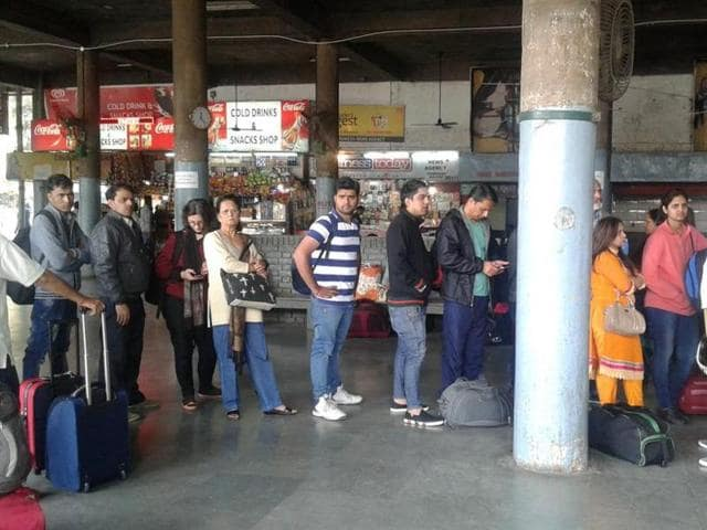 Passenger queue up to buy tickets for the Volvo buses toDelhi atISBT,Sector 17 inChandigarh on Wednesday.