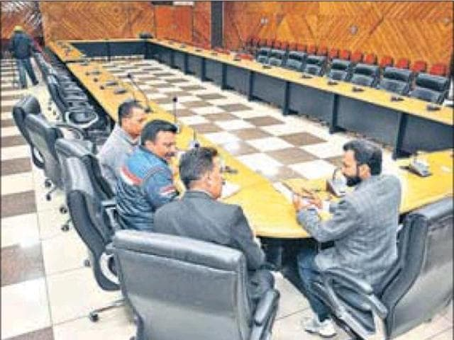 Officials of the district administration waiting for representatives of private schools for a meeting over the Safe School Vahan Scheme in Jalandhar recently.