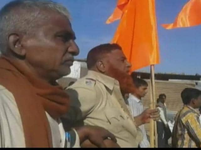 Muslim police officers were forced  to carry around a saffron flag in Maharashtra's Latur district