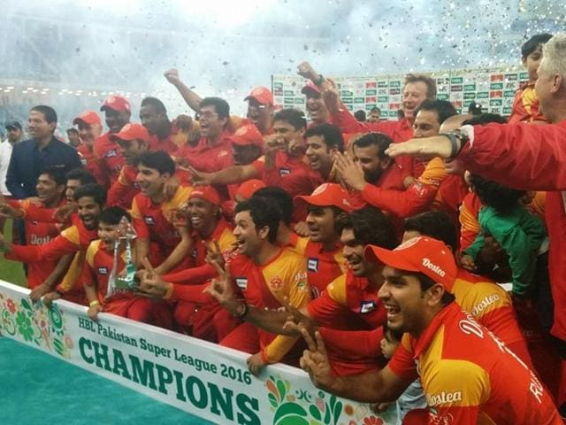 The Islamabad United side celebrate with the trophy after winning the inaugural edition of the Pakistan Super League.