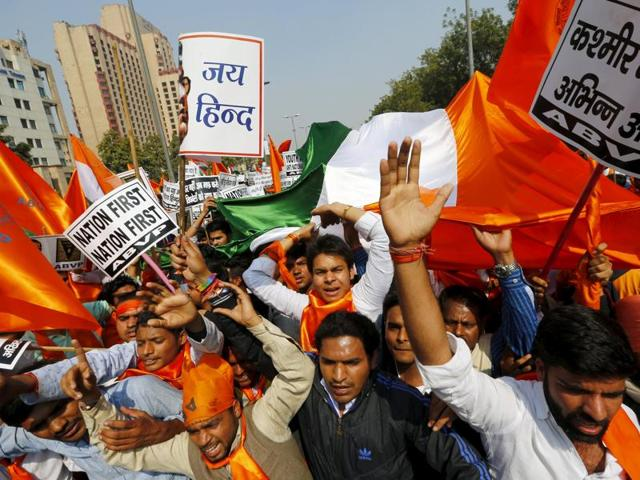 Activists from the right-wing Indian student organisation Akhil Bharatiya Vidyarthi Parishad (ABVP) listen to a speech of their leaders at a protest against students from Jawaharlal Nehru University (JNU).