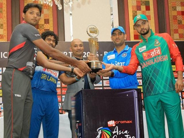 Captains from the four competing nations pose with the Asia Cup tournament trophy.
