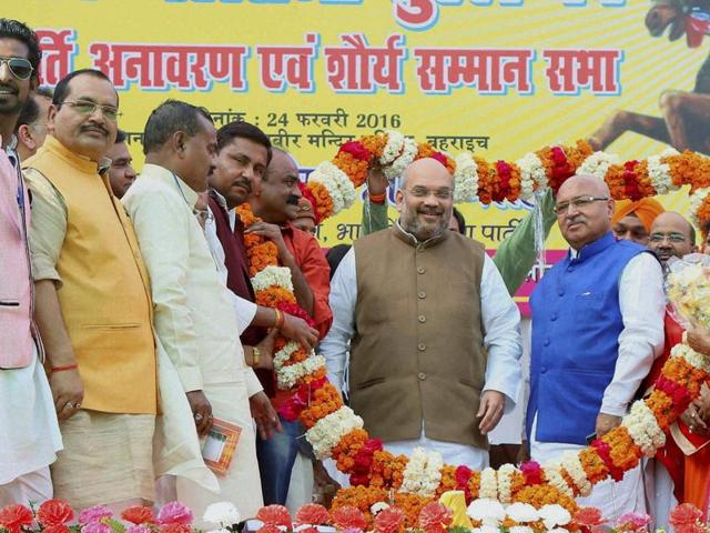 BJP President Amit Shah is garlanded by party workers at a function in Bahraich on Wednesday.