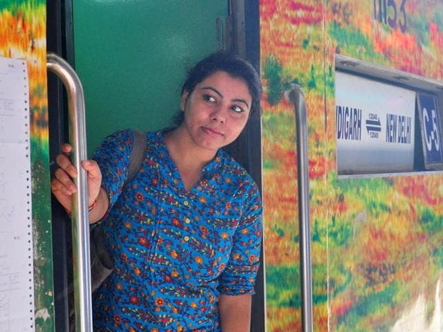 A passenger aboard the Shatabdi Express to Delhi at the Chandigarh railway station on Wednesday.