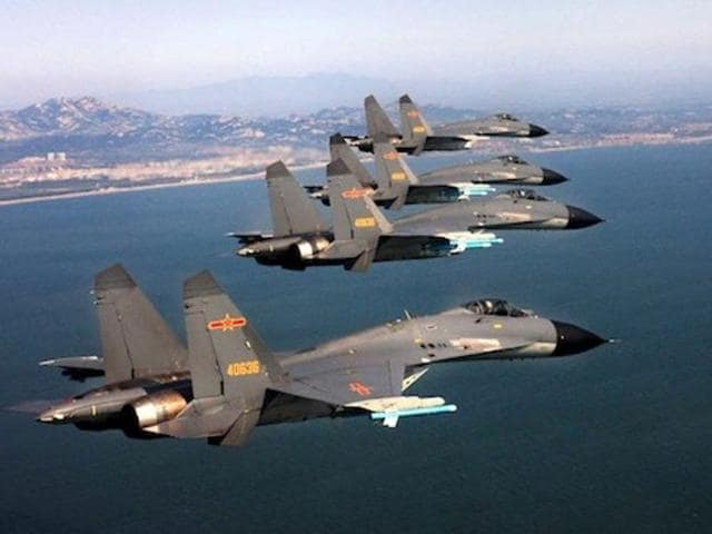 J-11 fighter jets of the Jinan Military Region of Chinas PLA Air Force fly over the sea during a combat training . China has deployed fighter jets to the disputed South China Seas territory.
