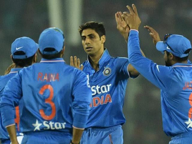 Ashish Nehra celebrates with teammates after the dismissal of Bangladesh batsman Mohammad Mithun.