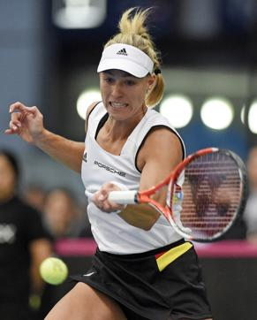 Angelique Kerber of Germany lost in straight sets against Zheng Saisai at the Qatar Open.  (AP Photo/Jens Meyer)