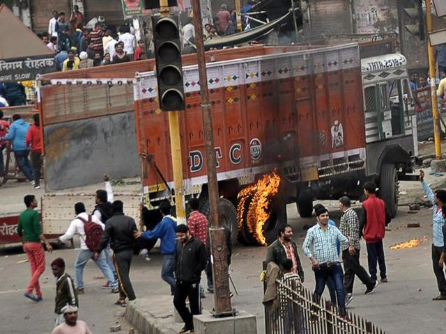 Police lathi charge protesters after violence erupted between two communities in Ranchi.