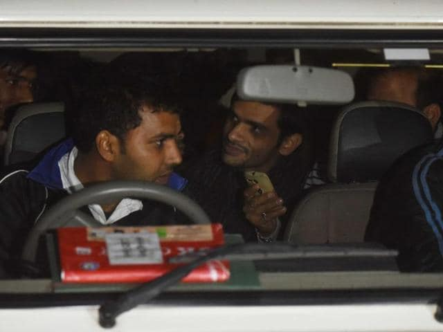 Umar Khalid as they were leaving to surrender from JNU in New Delhi
