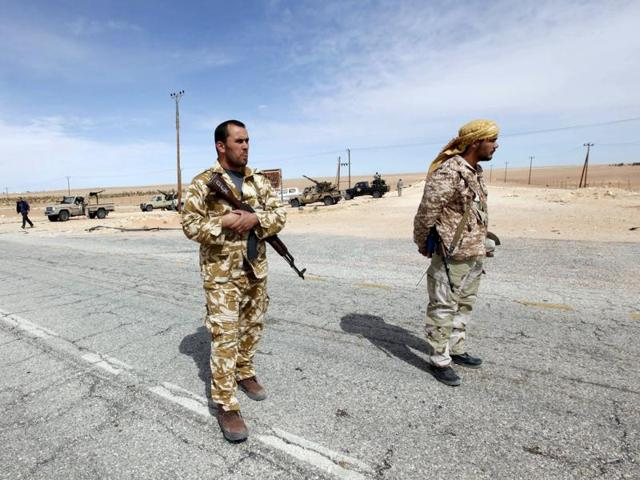 Libyan soldiers manning a military outpost near Tripoli.