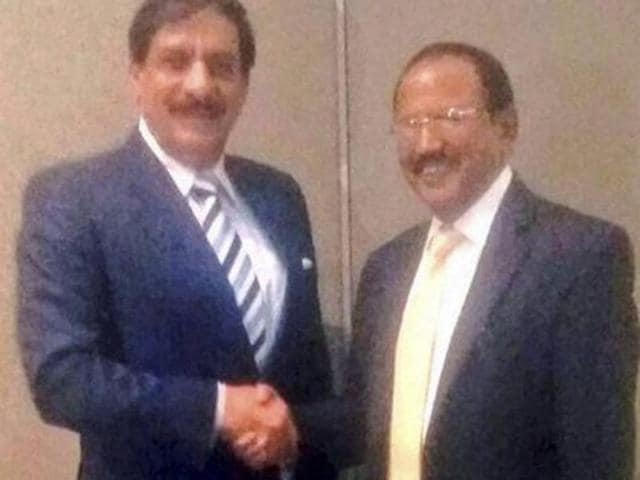 A file photo shows national security advisor Ajit Doval interacts with his Pakistani counterpart Naseer Khan during a delegation-level meeting in Bangkok.