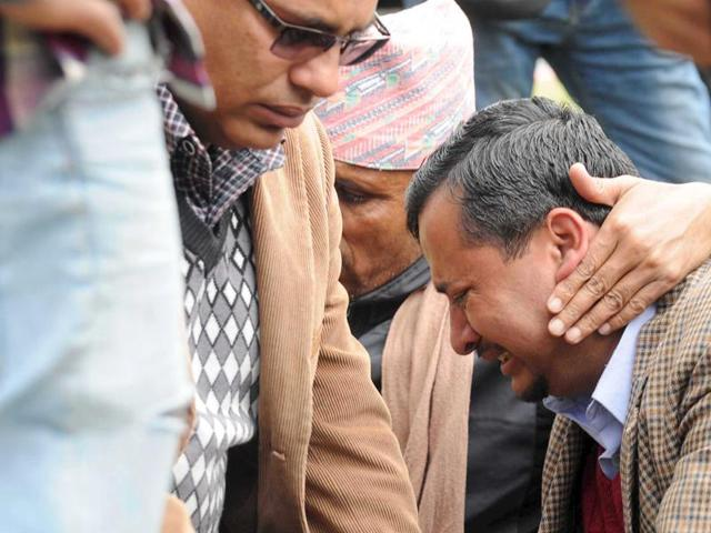 A family member cries as he waits at the airport after a Twin Otter plane, operated by private Tara Air, crashed in bad weather, in Pokhara, Nepal.