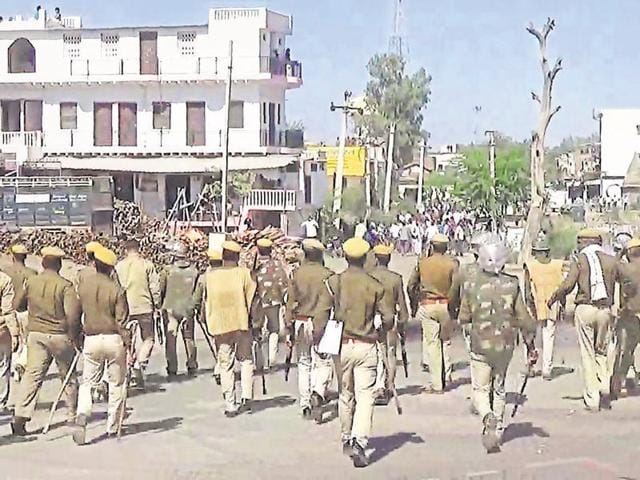 Police personnel try to disperse Jat protesters in Bharatpur on Tuesday afternoon.