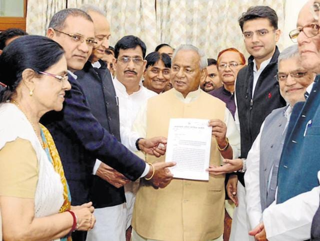 A Congress delegation submits a memorandum to governor Kalyan Singh in Jaipur on Tuesday.