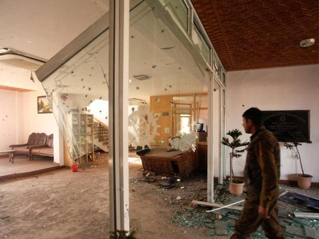 Damaged interiors of the EDI building where militants were holed up during a two-day gunfight in Pampore .