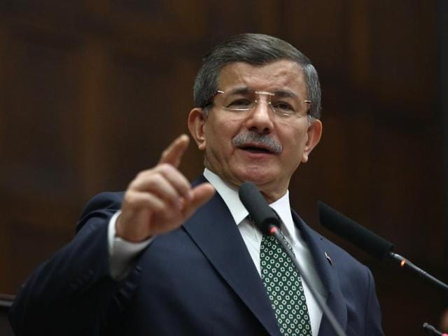 Turkish Prime Minister Ahmet Davutoglu addresses his lawmakers in Ankara.