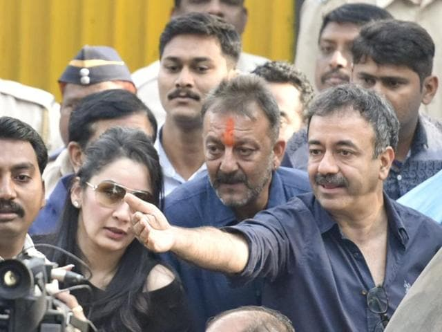 Actor Sanjay Dutt with wife Manyata (l) and filmmaker Rajkumar Hirani (r) after he was released from Pune's Yerawada jail on Thursday.