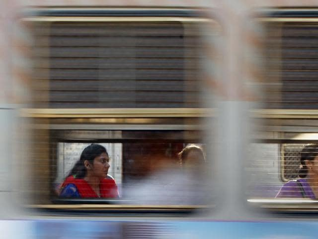 People are seen on a train at Mumbai's Bandra station on Thursday. Railway Minister Suresh Prabhu's on Thursday had no populist measures.