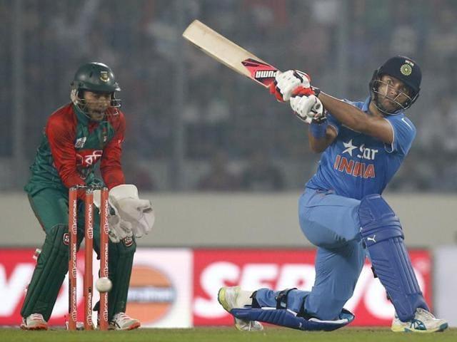 Yuvraj Singh plays a shot against Bangladesh during the Asia Cup Twenty20 international  tournament.