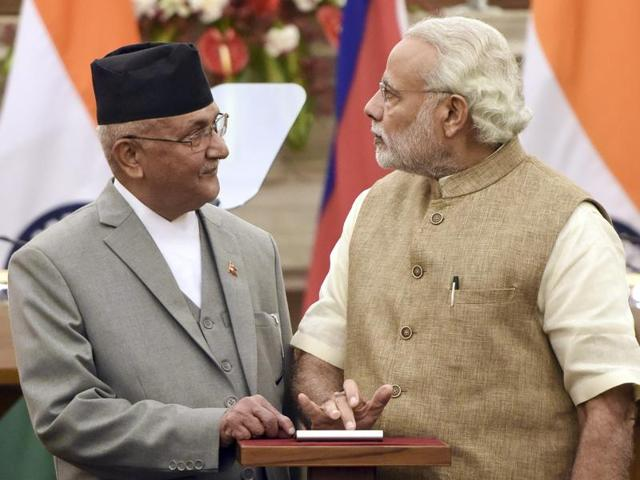 Prime Minister Narendra Modi interacts with his Nepalese counterpart, KP Oli , during the latter's  visit to New Delhi recently.