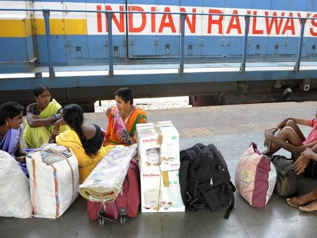 Indian passengers walk past stationary trains at platforms of Secunderabad Railway Station in Hyderabad on February 25, 2016, as Railways Minister Suresh Prabhu presentsed the rail budget in the Parliament House in New Delhi.