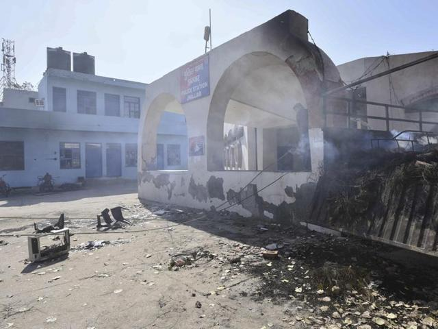 The burned Jhajjar police station during the Jat  quota stir in Haryana India.
