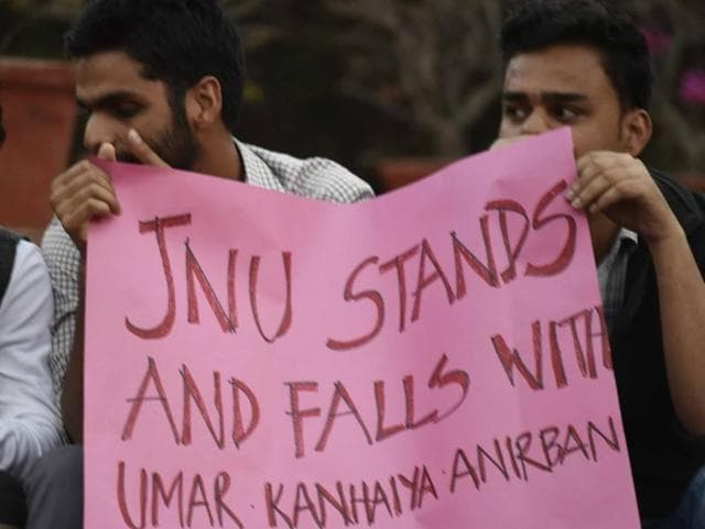 JNU teachers and students form a human chain inside the campus in protest against the arrest of JNUSU president Kanhaiya at JNU campus, in New Delhi.