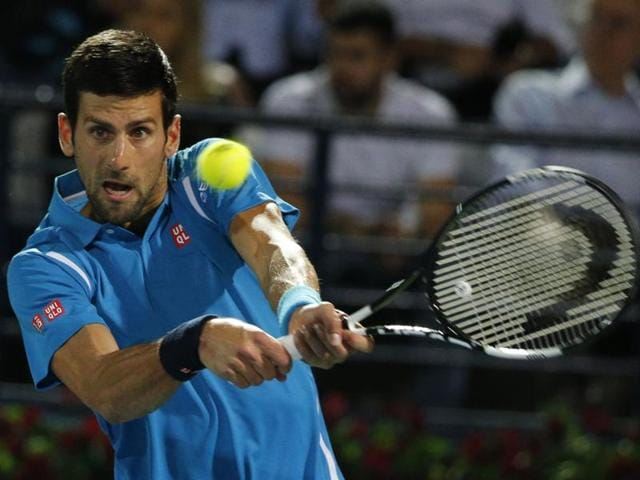 Novak Djokovic returns the ball to Tunisian Malek Jaziri during their ATP tennis match.