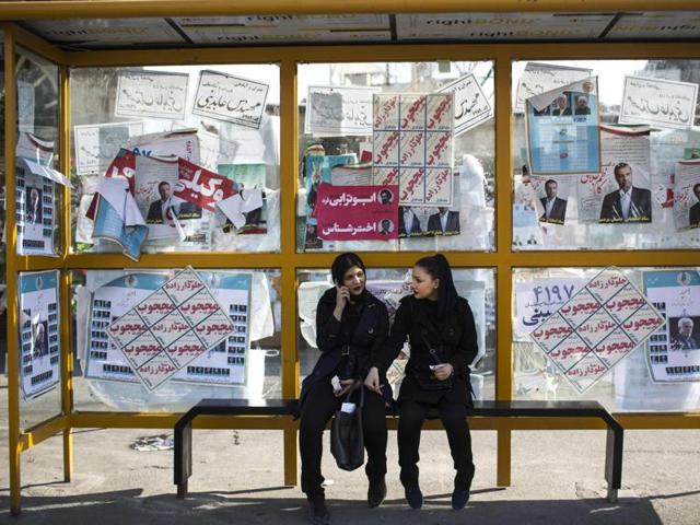An Iranian man stands next to electoral posterss of the upcoming parliamentary elections in downtown Tehran on February 25, 2016.