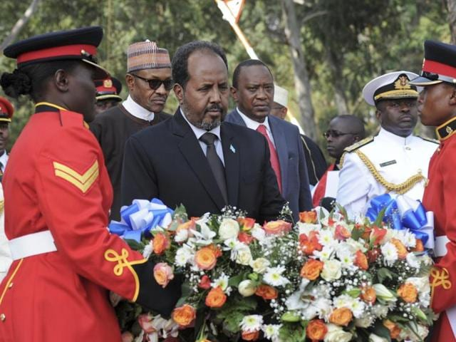 In this Jan. 27, 2016 file photo, Somalia's President Hassan Sheikh Mohamud, center, lays a wreath at an interfaith memorial service honouring Kenyan soldiers killed while on peacekeeping duty in Somalia, at a military barracks in Eldoret, Kenya.