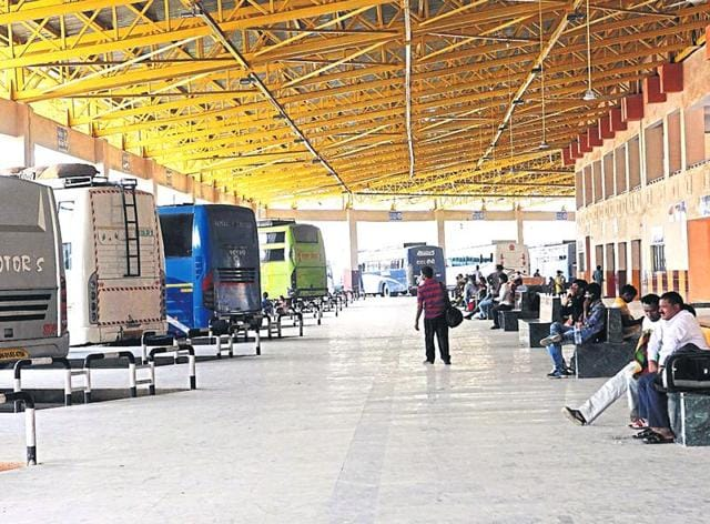 Passengers wait in vain for their buses at Birsa Munda terminal in Ranchi on Thursday, as bus operators went on a strike to protest against transport authority's move to curtail halt time of buses.