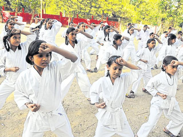Hearing and speech impaired children being trained for self-defence at Pardeshipura complex in Indore on Thursday.