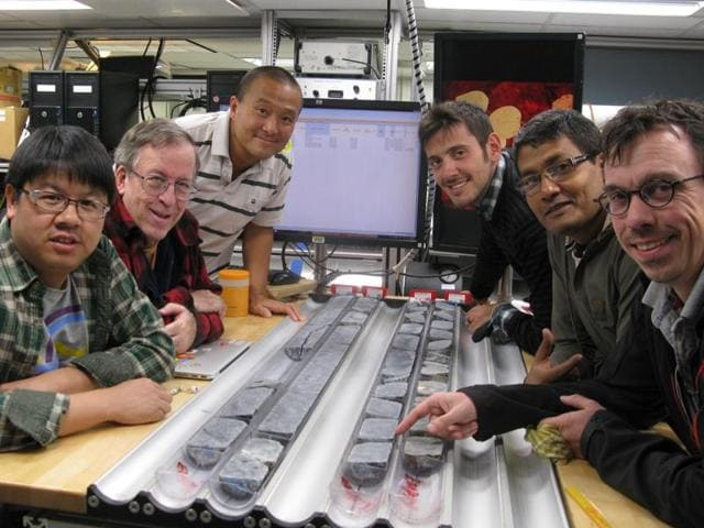 In this handout photo, the team of scientists of the International Ocean Discovery Programme which is drilling the ocean crust to the mantle of the earth, can be seen.  An Indian, Biswajit Ghosh (2nd on the right side) is part of the team.  (HTPhoto / via Biswajit Ghosh)