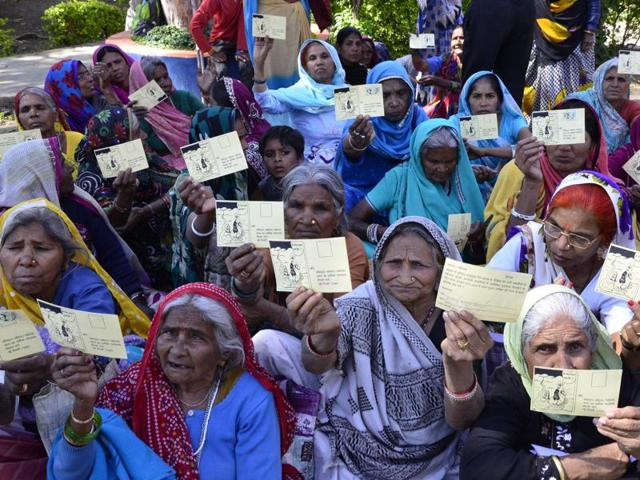 Bhopal gas disaster victims at a campaign to send postcards to the registrar of Supreme Court demanding urgent hearing of the additional compensation case, in Bhopal on Thursday.