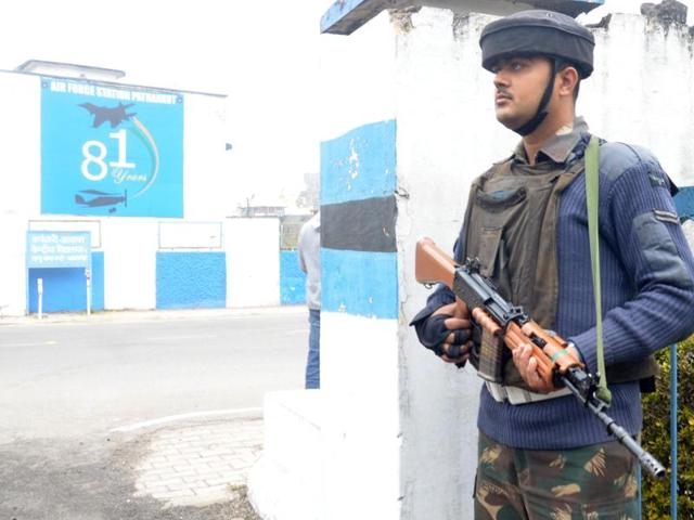 Soldiers stand guard inside an airbase in Pathankot.