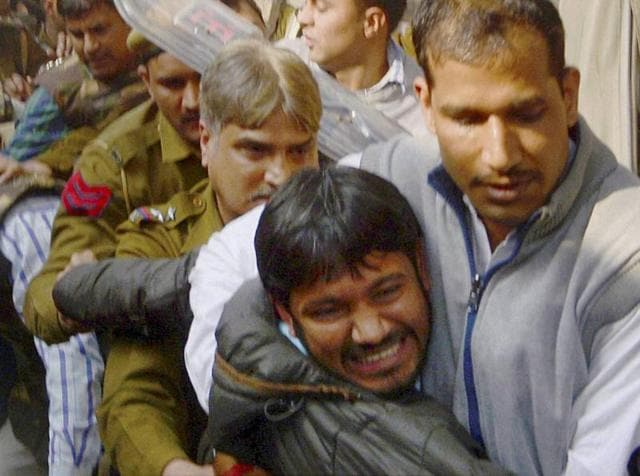 A lawyer (C), who spoke to the media supporting JNU student leader Kanhaiya Kumar, is beaten up by other lawyers outside Patiala House courts in New Delhi.