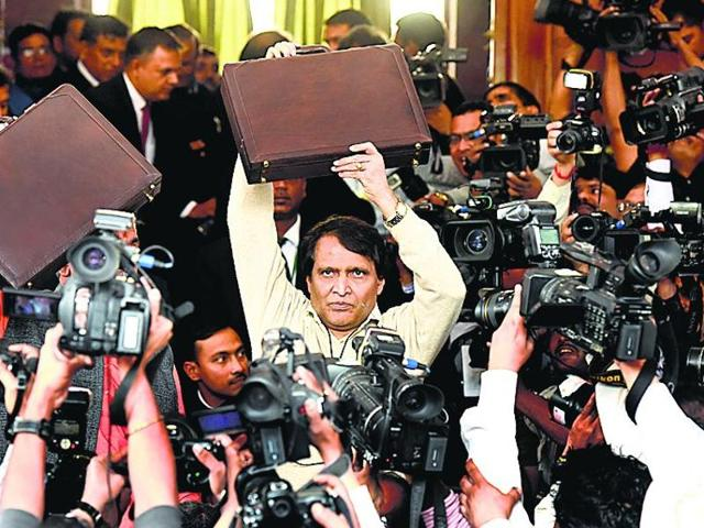 Suresh Prabhu poses for the cameras before presenting the rail budget in Parliament.