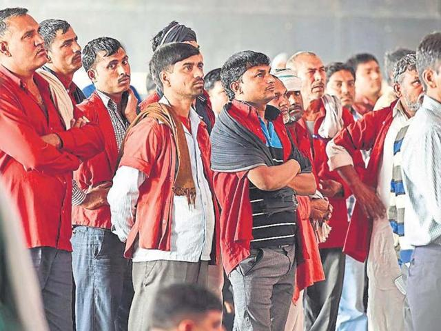 Railway porters watching the rail budget on television at the New Delhi Railway Station on Thursday, February 25, 2016.
