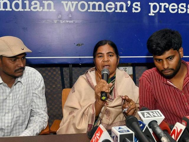Dalit research scholar Rohith Vemula's mother Radhika and his brother (L) with Prasanth Dontha, a student expelled from Hyderabad University, at a press conference in New Delhi on Friday.