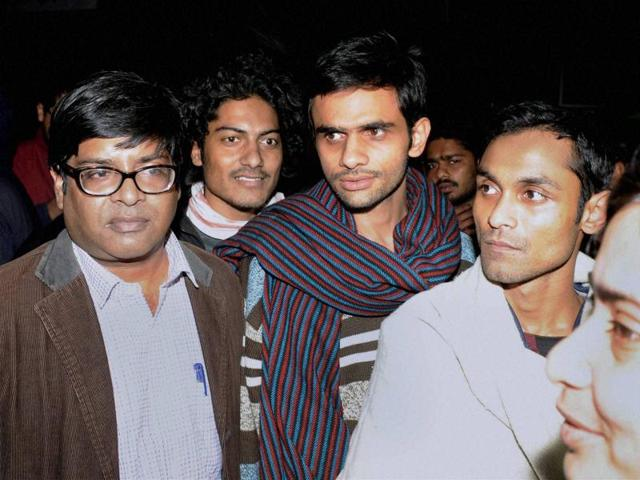 JNU students Umar Khalid (centre) and Anirban Bhattacharya (right) come out of JNU campus to surrender before the Delhi Police.
