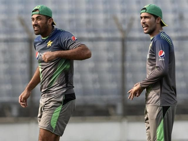 Pakistan cricketers Wahab Riaz (L) and Mohammad Amir attend a training session.