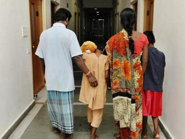 In this file photo, the minor girl (centre), who was raped by a man in Dumaria, is seen being escorted by her parents at a private hospital in Ranchi.